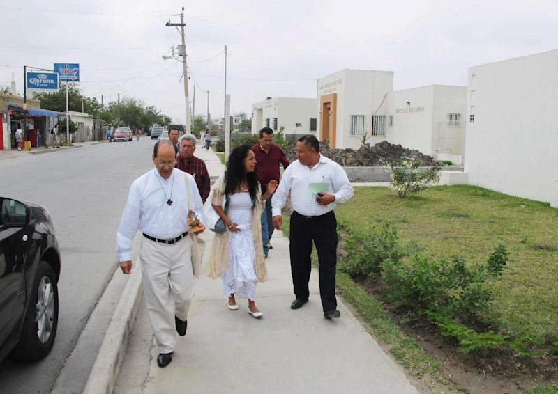 The Rev. Alejandro Solalinde, left, a Catholic priest visiting from southern Mexico, and Rev. Francisco Gallardo, right, walk outside the migrant shelter in Matamoros, Mexico on April 8, 2013. After gunmen kidnapped 15 people from the shelter it began encouraging migrants to go into the streets during the day to become more difficult targets for organized crime. (AP Photo/Christopher Sherman)