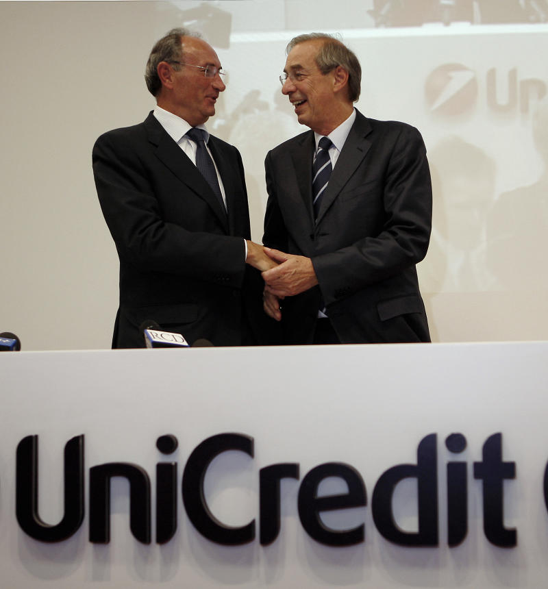 Unicredit bank CEO Federico Ghizzoni, left, and Unicredit President  Dieter Rampl shake hands prior to a press conference in downtown Milan, Italy, Friday, Oct. 1, 2010.  Unicredit SpA named its No. 2 Federico Ghizzoni as chief executive on Thursday Sept. 30, 2010 to replace Alessandro Profumo, ousted in a politicized battle sparked by Libya's increased share in Italy's biggest bank. Ghizzoni, 54, had been one of four deputy chief executives under Profumo, responsible for the bank's operations in central and eastern Europe. (AP Photo/Antonio Calanni)