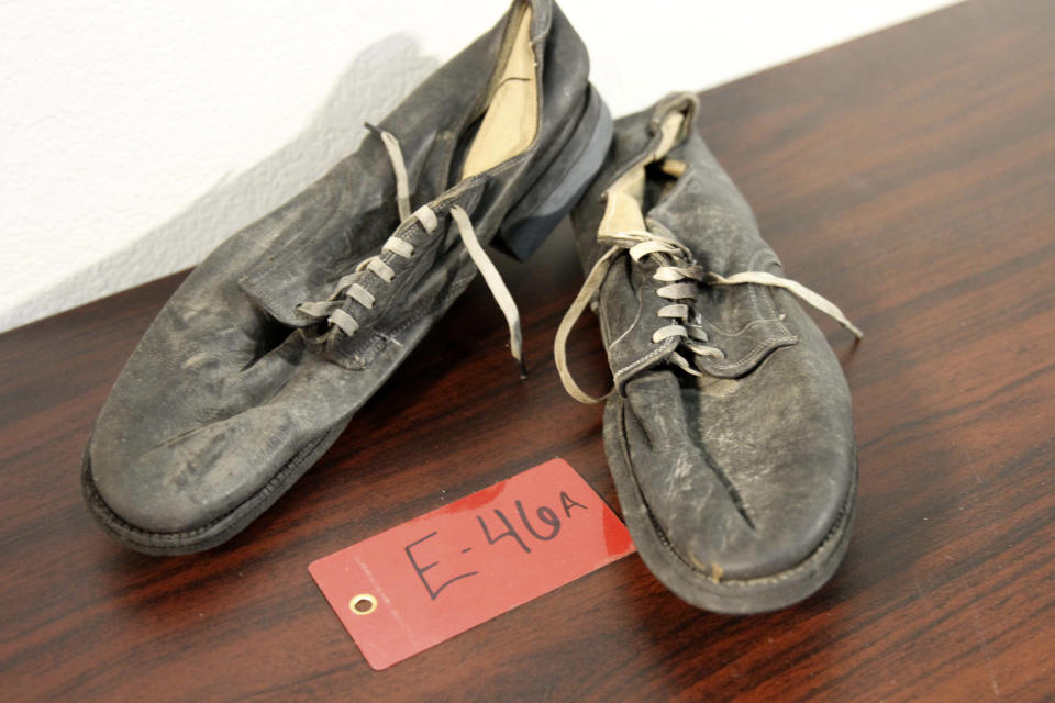 A pair of shoes recovered from the 1952 crash of a C-124 Globemaster were found this month on Colony Glacier and displayed at Joint Base Elmendorf-Richardson, Alaska, Tuesday, Sept. 29, 2021. The plane slammed into a mountain, killing 52 on board, and the plane and its crew have since become part of the glacier. The military has conducted annual summer recovery efforts, finding human remains and personal items on the glacier. (AP Photo/Mark Thiessen)