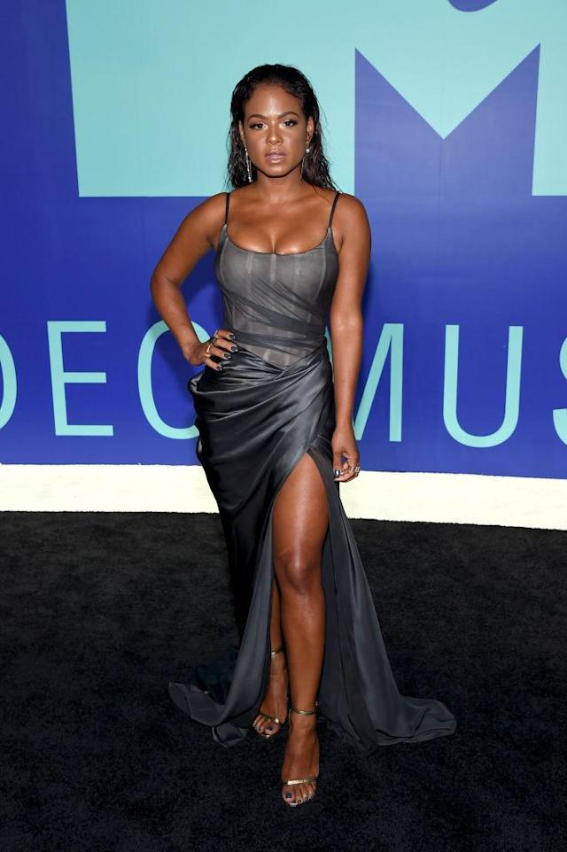 <p>Christina Milian glowed in a gray gown with a thigh-high slit. (Photo: Getty Images) </p>