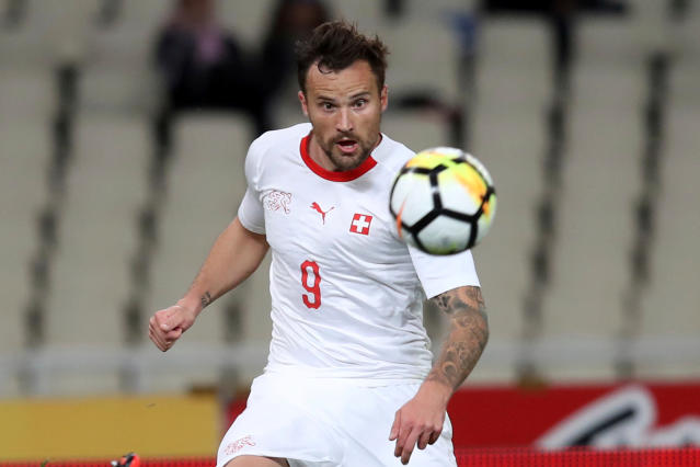 In this photo taken on Friday, March 23, 2018, Switzerland's Haris Seferovic eyes the ball during an international friendly soccer match against Greece at the Olympic stadium in Athens. (AP Photo/Thanassis Stavrakis)