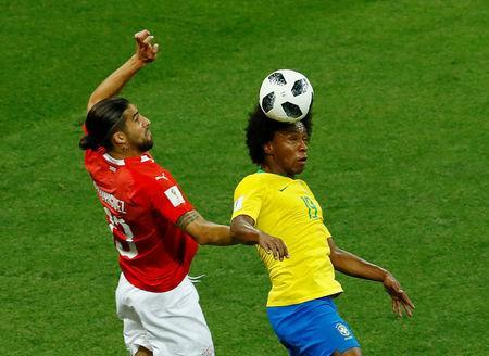 Soccer Football - World Cup - Group E - Brazil vs Switzerland - Rostov Arena, Rostov-on-Don, Russia - June 17, 2018 Switzerland's Ricardo Rodriguez in action with Brazil's Willian REUTERS/Jason Cairnduff