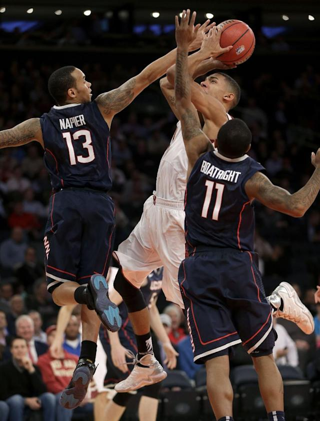 Boston College's Olivier Hanlan, center, tries to shoot past Connecticut's Shabazz Napier, left, and Ryan Boatright during the second half of an NCAA college basketball game on Thursday, Nov. 21, 2013, in New York. Connecticut defeated Boston College 72-70. (AP Photo/Seth Wenig)