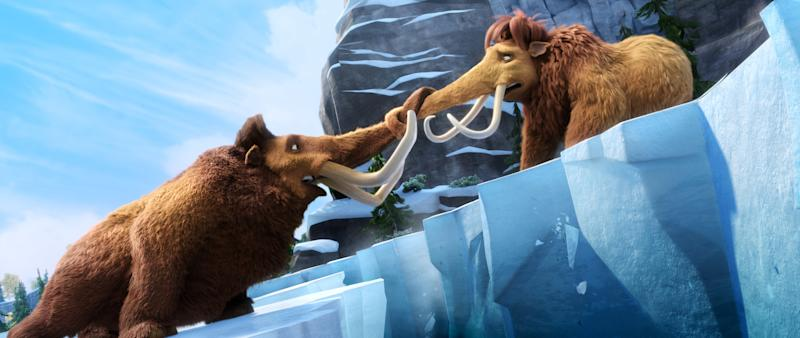 "This image released by 20th Century Fox shows Manny voiced by Ray Romano, left, and Ellie, voiced by Queen Latifah in a scene from the animated film, ""Ice Age: Continental Drift."" (AP Photo/20th Century Fox)"
