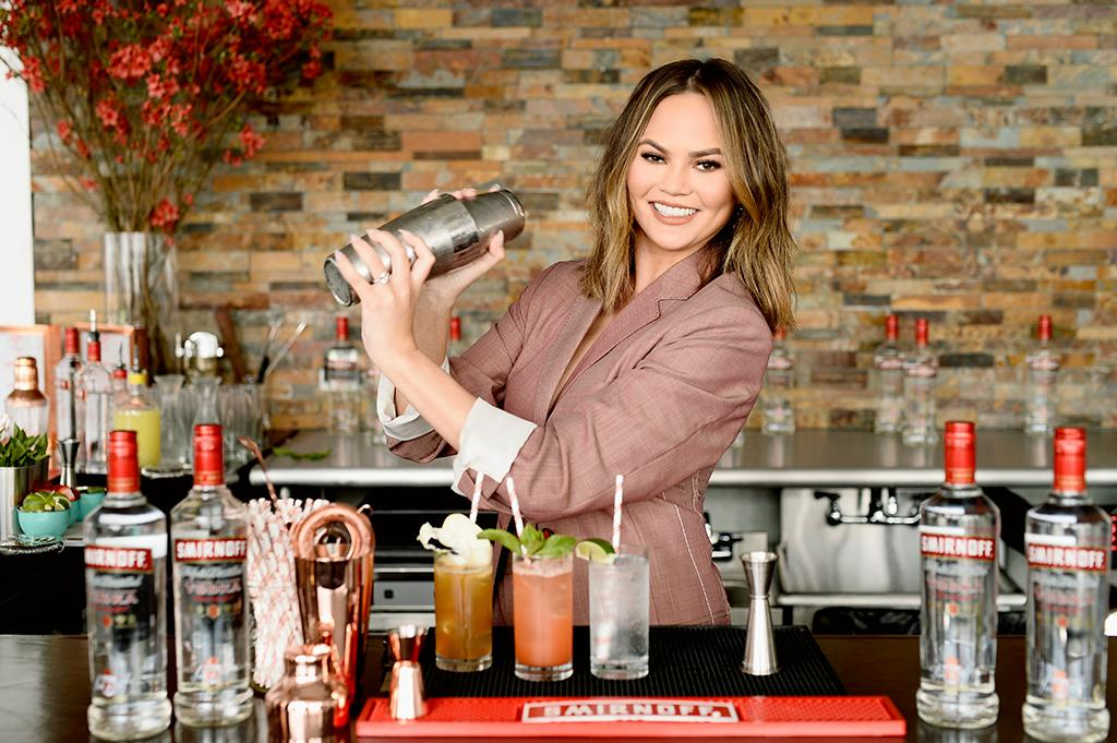 """<p>The social media maven mixed up cocktails at a New York City event for Smirnoff No. 21, where <a rel=""""nofollow"""" href=""""https://www.yahoo.com/celebrity/chrissy-teigen-reveals-john-legend-175044303.html"""">she also mused on hangover cures</a>. """"I think as long as you [drink] in moderation, that's the only cure — because everything else is bulls***,"""" she said. """"There's no real trick, there's no powder."""" (Photo: Dave Kotinsky/Getty Images for SMIRNOFF) </p>"""