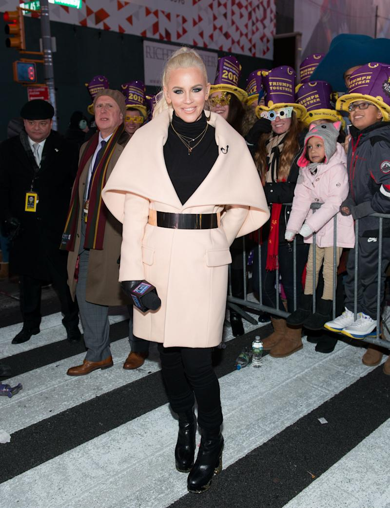 Jenny McCarthy poses on New Year's Eve holding a m