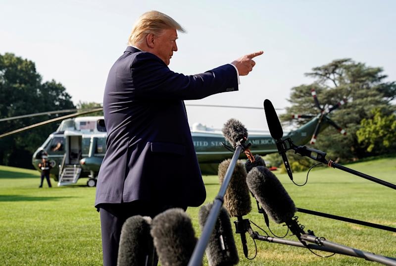 U.S. President Donald Trump speaks to reporters as he departs on travel to Dayton, Ohio and El Paso, Texas following back-to-back mass shootings in the cities, on the South Lawn of the White House in Washington, U.S., August 7, 2019. REUTERS/Kevin Lamarque TPX IMAGES OF THE DAY