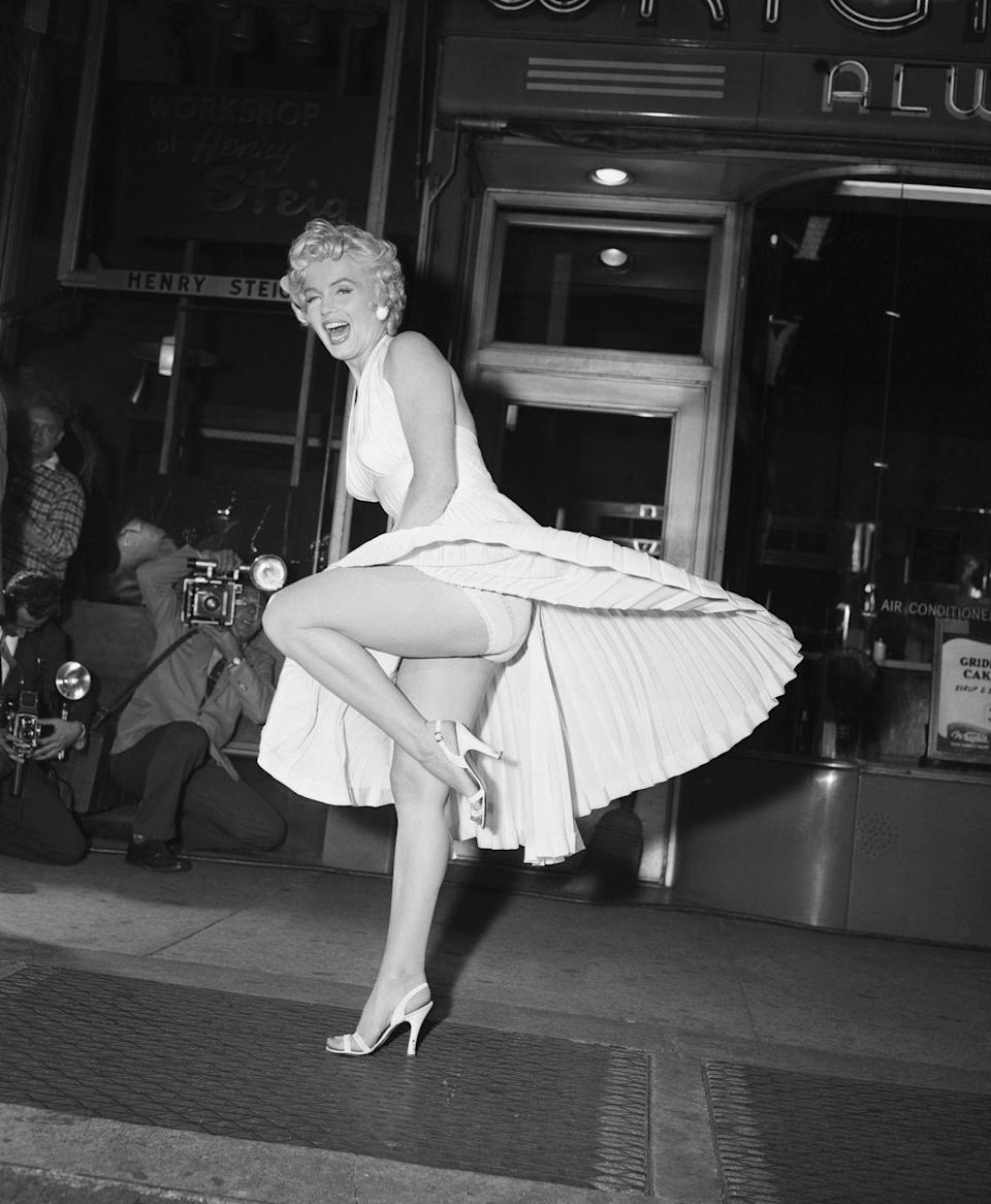 <p>We doubt <em>The Seven Year Itch</em> director Billy Wilder knew when he told Marilyn Monroe to pose on the subway grate that the image would become one of the most iconic in pop culture history. Monroe playfully worked with the upward breeze under her pleated white halter dress, and the movie went on to become a smashing success. </p>