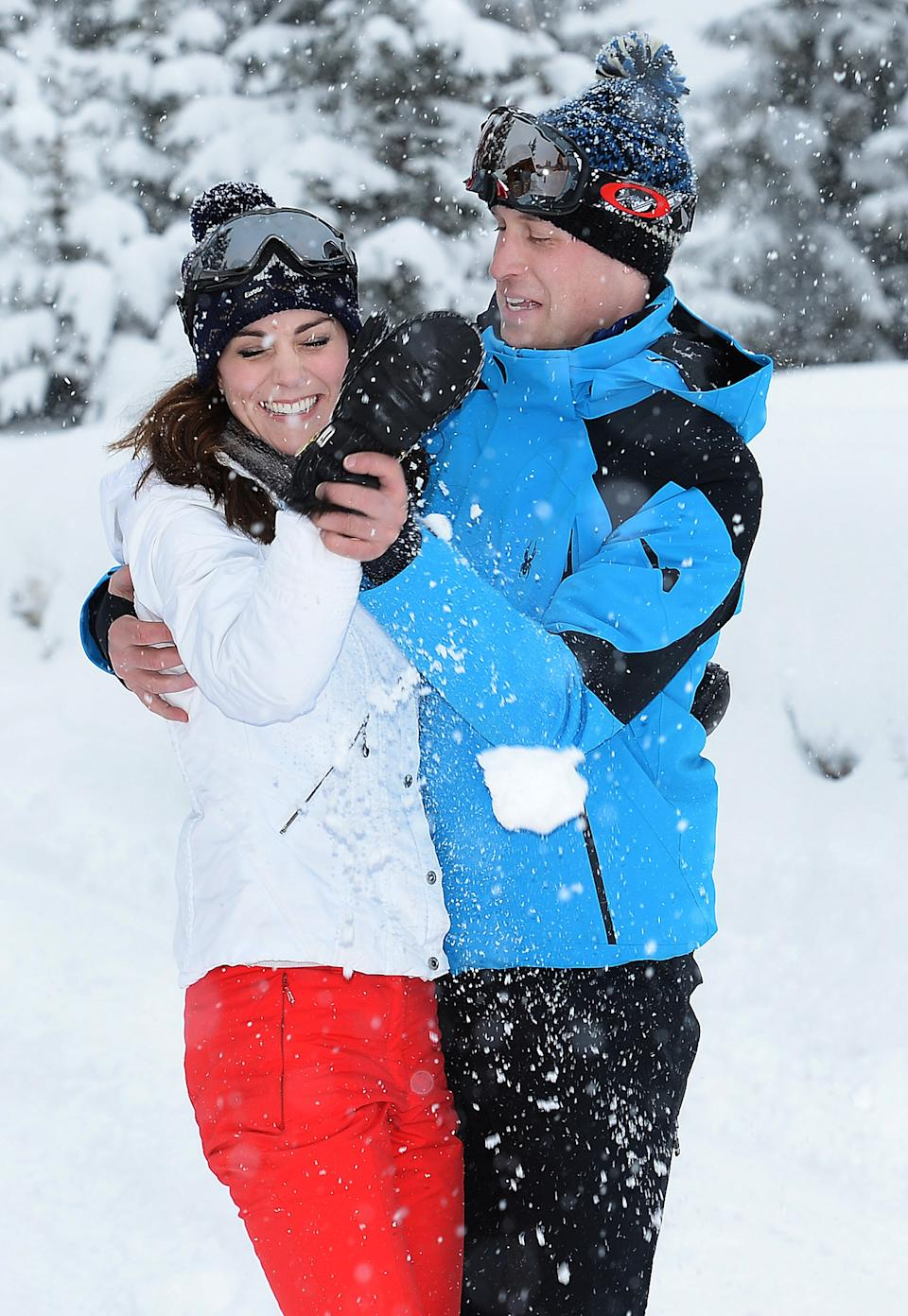 William gets his own back after the Duchess threw a snowball at him during a private break skiing in the French Alps in March 2016. (John Stillwell/AFP)