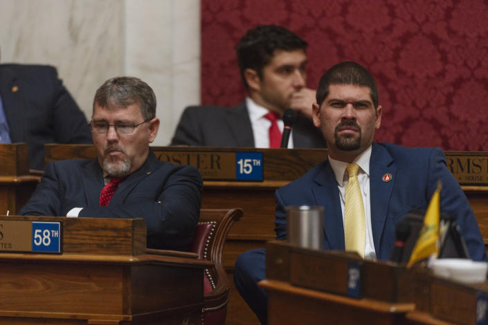 Majority Leader Daryl Cowles, R - Morgan, left, and staffer James Fuerhoff are seen during a special session of the state House of Delegates in Charleston, W.V., on Monday, Aug. 13, 2018. The delegates are voting on 15 articles of impeachment charges against Supreme Court Chief Justice Margaret Workman and Justices Robin Davis, Allen Loughry and Beth Walker. (Craig Hudson/Charleston Gazette-Mail via AP)