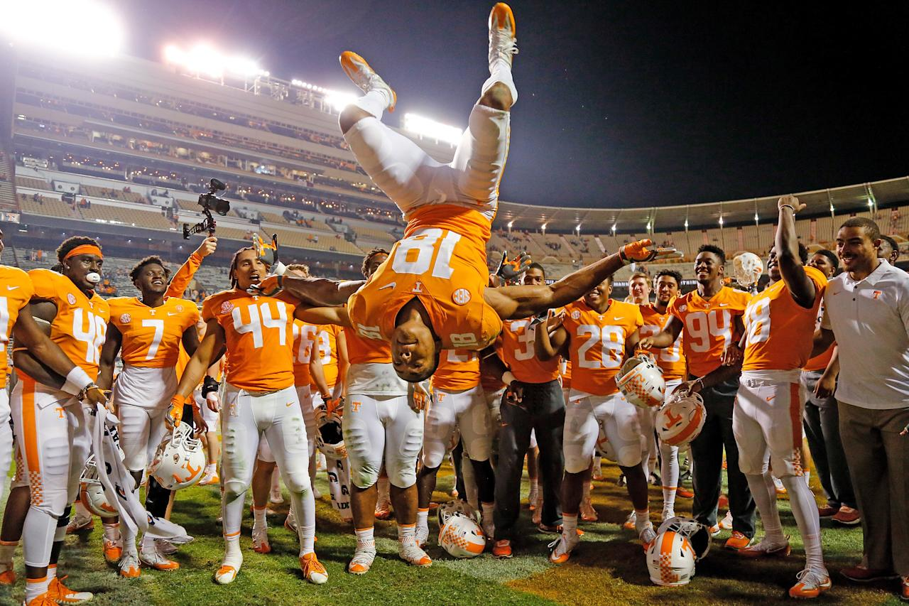 <p>Nigel Warrior #18 of the Tennessee Volunteers does a flip while celebrating after defeating the Southern Miss Golden Eagles at Neyland Stadium on November 4, 2017 in Knoxville, Tennessee. (Photo by Michael Reaves/Getty Images) </p>