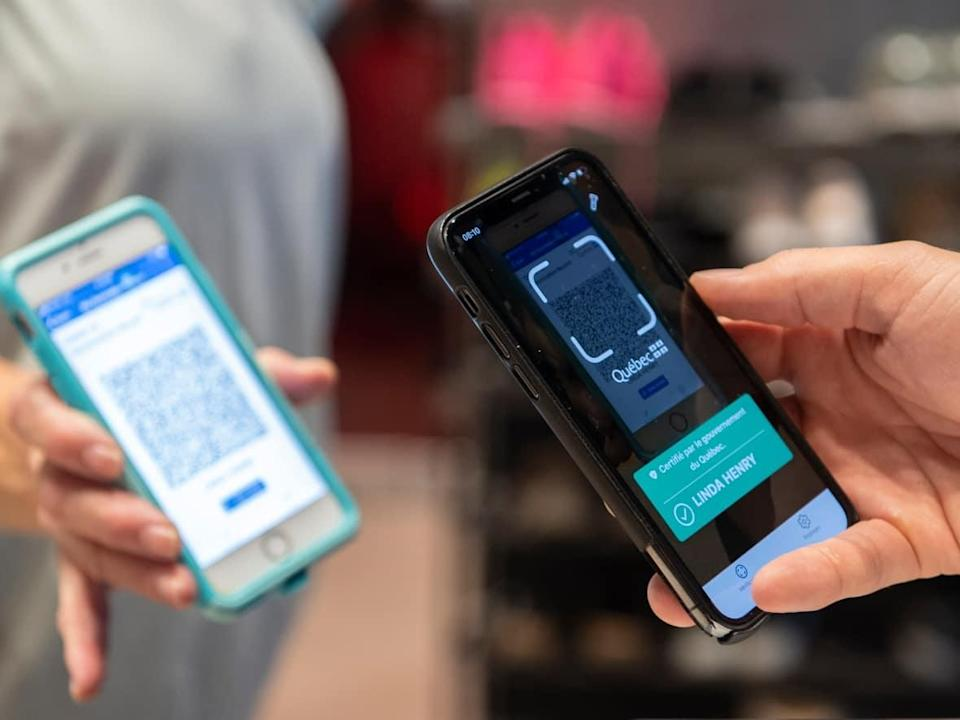 Newfoundland and Labrador's vaccine passport system, which is launching Friday and becomes mandatory on Oct. 22, is based on Quebec's system that uses QR codes and readers via an app, seen here.   (Graham Hughes/Canadian Press - image credit)