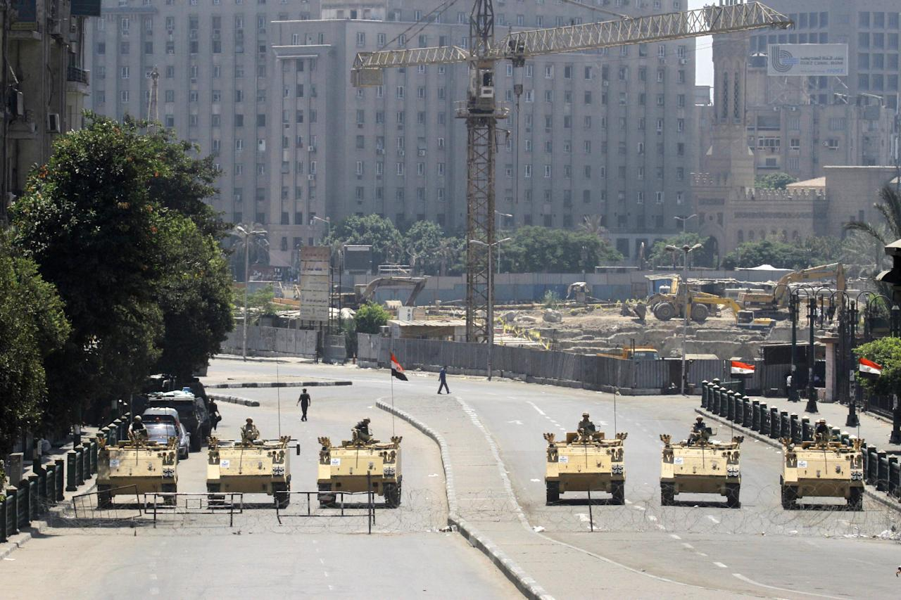 Egyptian army soldiers in armored vehicles block Tahrir Square in Cairo, Egypt, during mass protests Friday, Aug. 23, 2013. Egyptian security and military forces deployed Friday around Cairo, closing off traffic in some major thoroughfares and in the city center as hundreds of supporters of ousted President Mohammed Morsi took to the streets demanding his return to office.(AP Photo/Amr Nabil)