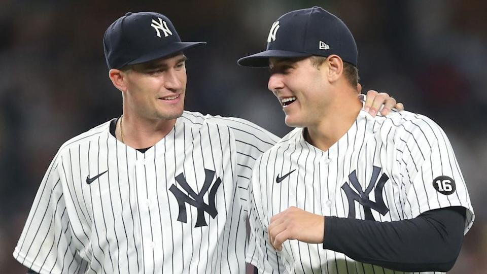 Andrew Heaney and Anthony Rizzo smiling home runiforms