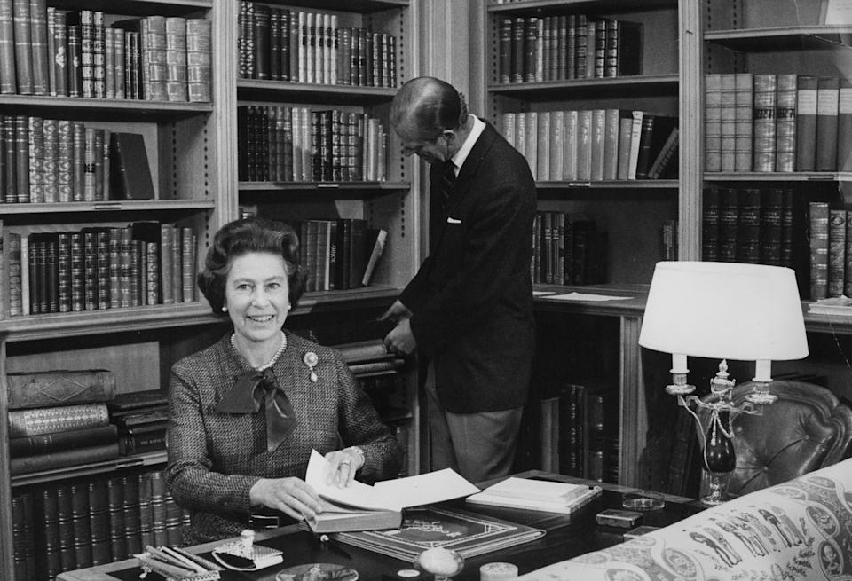 Queen Elizabeth II and the Duke of Edinburgh in the library at Balmoral during their traditional summer break.