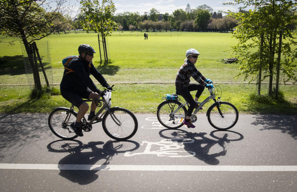 Cyclists exercise in The Meadows in Edinburgh as the UK continues in lockdown to help curb the spread of the coronavirus.