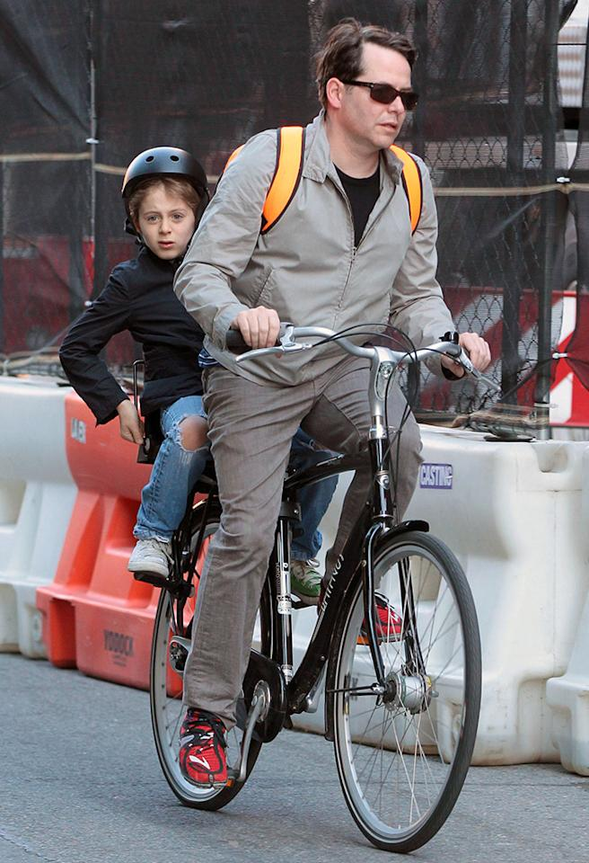 What do you do when your kid's got to get to school and you want to beat New York traffic? Throw him on the back of your bike! The 51-year-old father of three pedaled through the city streets on Tuesday and hopefully got 10-year-old son James Wilkie there in time for first period! (5/14/2013)