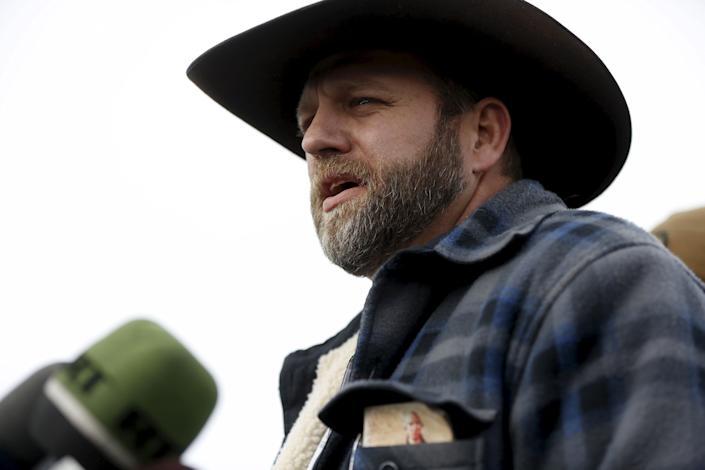 Ammon Bundy addresses the media at the Malheur National Wildlife Refuge near Burns, Oregon in January 2016, after a group of anti-government militia members took over the refuge headquarters. A copy of the annotated U.S. constitution, published by the religious group National Center for Constitutional Studies, can be seen in his jacket pocket. (Photo: Jim Urquhart / Reuters)