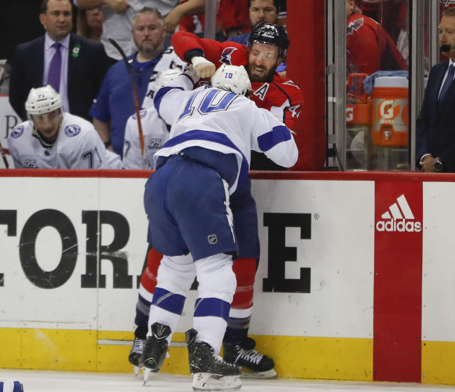 Washington Capitals defenseman Brooks Orpik (44) and Tampa Bay Lightning center J.T. Miller (10) exchange punches during the first period of Game 6 of the NHL Eastern Conference finals hockey playoff series Monday, May 21, 2018, in Washington. Both players received five-minute penalties for fighting. (AP Photo/Pablo Martinez Monsivais)