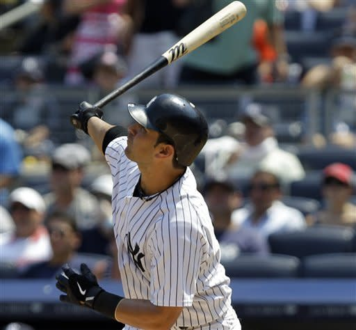 New York Yankees Eric Chavez hits a second-inning, two-run, home run during their baseball game against the Chicago White Sox at Yankee Stadium in New York, Sunday, July 1, 2012. (AP Photo/Kathy Willens)