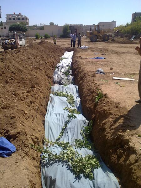 FILE - This Sunday, Aug. 26, 2012 file photo provided by Shaam News Network SNN purports to show victims killed by shabiha pro-government militiamen being buried in a mass grave in Daraya, Syria. According to activists' accounts, government forces retook the Damascus suburb of Daraya from rebel control three days earlier and went on a killing spree. Reports of the death toll range widely from more than 300 to as many as 600. Sectarian slayings between Syria's Sunni majority and the Alawite minority have been a brutal reality of Syria's 17-month-old conflict, and they have only accelerated as the country falls into outright civil war. (AP Photo/Shaam News Network, SNN, File) THE ASSOCIATED PRESS IS UNABLE TO INDEPENDENTLY VERIFY THE AUTHENTICITY, CONTENT, LOCATION OR DATE OF THIS CITIZEN JOURNALIST IMAGE