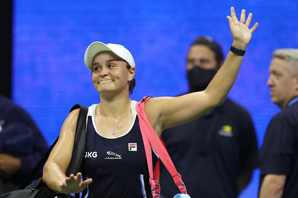 Ash Barty (pictured) walks off the court after a loss to Shelby Rogers at the US Open.