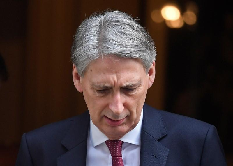 Britain's Chancellor of the Exchequer Hammond leaves his official residence in Downing Street in London, Britain
