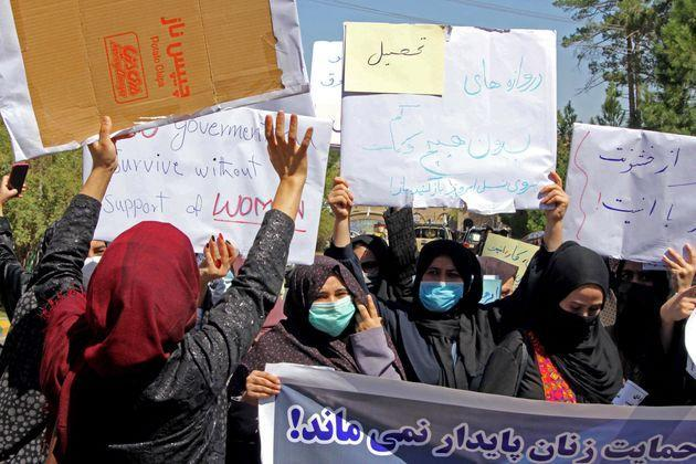 Afghan women hold placards as they take part in a protest in Herat on September 2, 2021. - Defiant Afghan women held a rare protest on September 2 saying they were willing to accept the all-encompassing burqa if their daughters could still go to school under Taliban rule. (Photo by - / AFP) (Photo by -/AFP via Getty Images) (Photo: - via Getty Images)