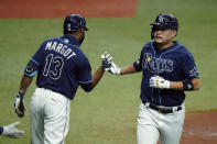 Tampa Bay Rays' Yoshitomo Tsutsugo, of Japan, celebrates his solo home run off Miami Marlins starting pitcher Pablo Lopez with on-deck batter Manuel Margot (13) during the second inning of a baseball game Friday, Sept. 4, 2020, in St. Petersburg, Fla. (AP Photo/Chris O'Meara)