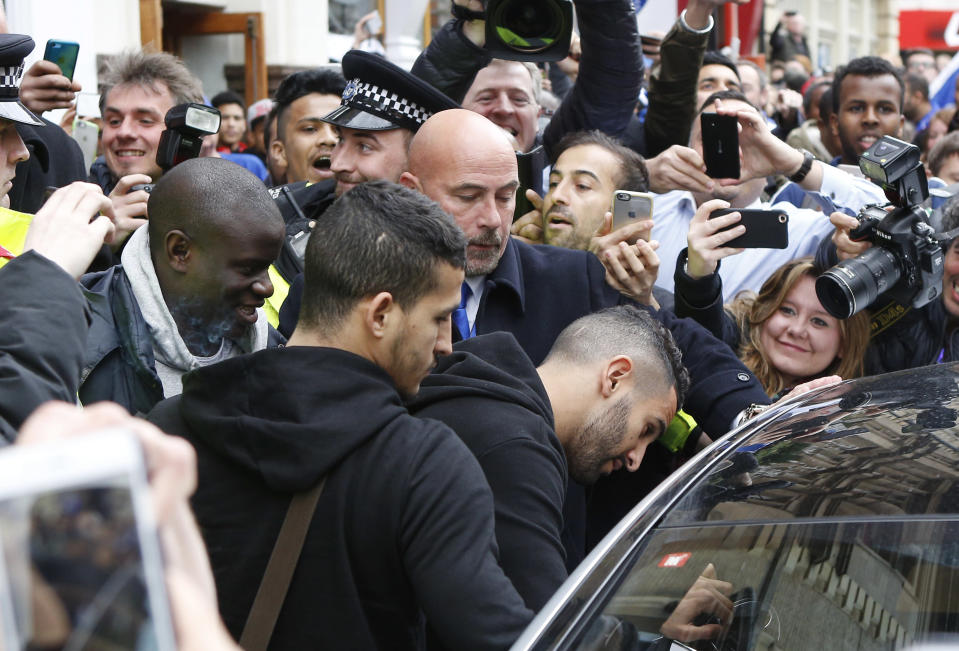 Britain Soccer Football - Leicester City celebrate winning Premier League title - Leicester - 3/5/16 Leicester's Riyad Mahrez and N'Golo Kante leave San Carlo restaurant where the Leicester team are having lunch Action Images via Reuters / Craig Brough Livepic EDITORIAL USE ONLY.