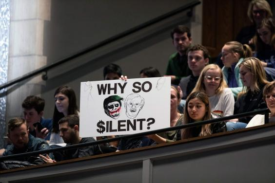 Protesters hold up a sign comparing Donald Trump to The Joker during a talk by former national security adviser at Duke University in North Carolina (AFP via Getty Images)