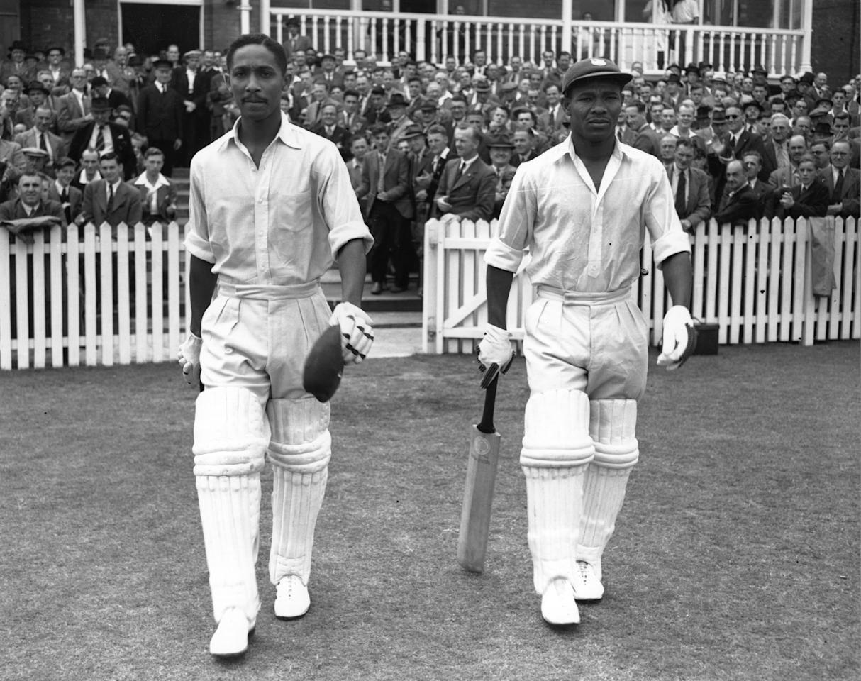 West Indies cricketers Frank Worrell (1924 - 1967) (left), and Everton Weekes go out to resume their record-making innings against England at Trent Bridge.    (Photo by Central Press/Getty Images)