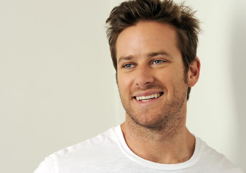 "In this Monday, June 10, 2013 photo, actor Armie Hammer laughs as he poses for a portrait at the Pacific Design Center in West Hollywood, Calif. Hammer takes on his first major leading-man role opposite Johnny Depp in ""The Lone Ranger."" The movie releases July 3, 2013. (Photo by Chris Pizzello/Invision/AP)"