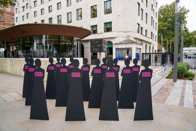 <strong>Silhouettes of women are placed outside New Scotland Yard by the British charity Refuge.</strong> (Photo: via Associated Press)