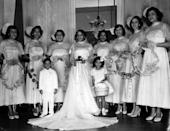 <p>From the strapless bridesmaids gowns to their fun fascinators, this bridal party would actually be appropriate today.</p>