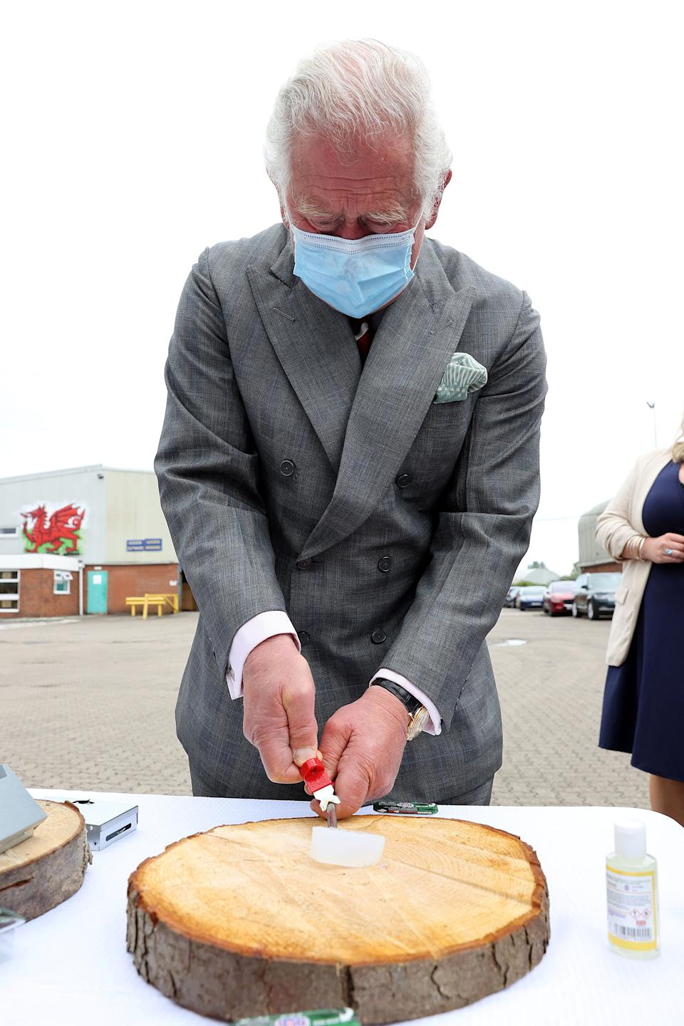 Britain's Prince Charles, Prince of Wales lights Fire Dragon fuel during a visit to BCB International, a supplier of protective, medical and defence equipment, in Cardiff on May 14, 2021, during his day-long visit to Wales. (Photo by Chris Jackson / POOL / AFP) (Photo by CHRIS JACKSON/POOL/AFP via Getty Images)