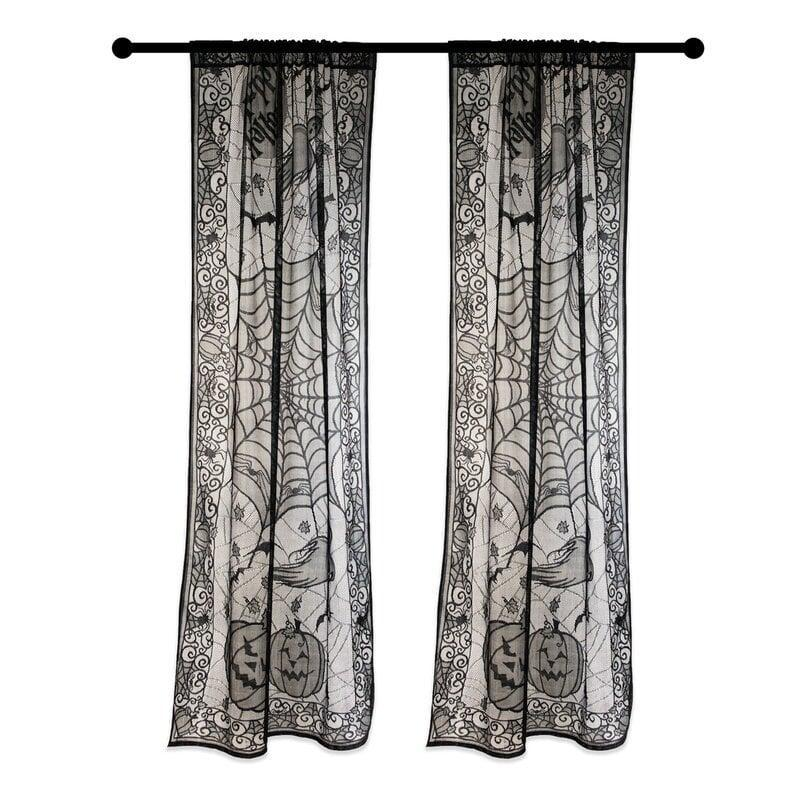 <p>Complement your windows with the weather-resistant <span>The Holiday Aisle Happy Halloween Lace Panel Door Mural </span>($15). Even during those windy or rainy Autumn nights, you won't have to worry about this piece falling apart. You can also use this on your wall or door!</p>