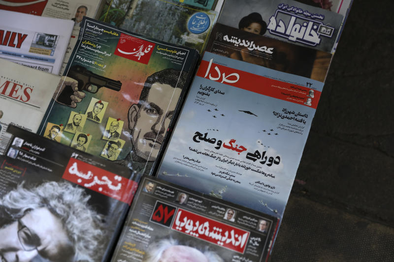 The front cover of the May 11, 2019 edition of the weekly reformist magazine, Seda, center right, is on display at a news stand in downtown Tehran, Iran, May 12, 2019. Iranian authorities shut down the magazine that had urged negotiations with the United States, local media reported Sunday. (AP Photo/Vahid Salemi)