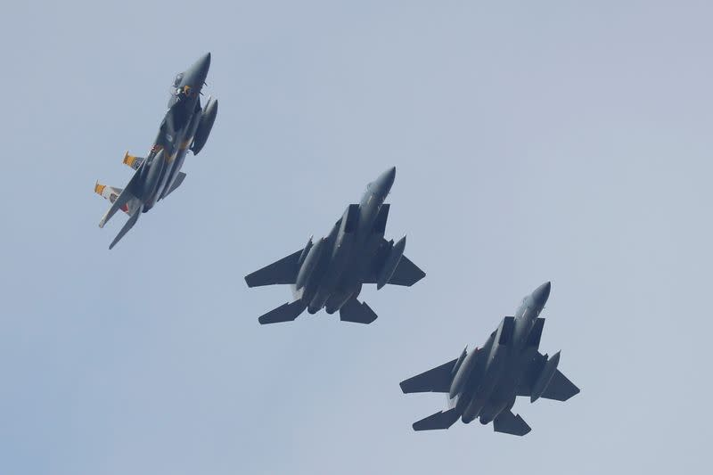 FILE PHOTO: U.S. Air Force F-15 fighter jets fly in formation during the Clear Sky 2018 multinational military drills in Khmelnytskyi Region