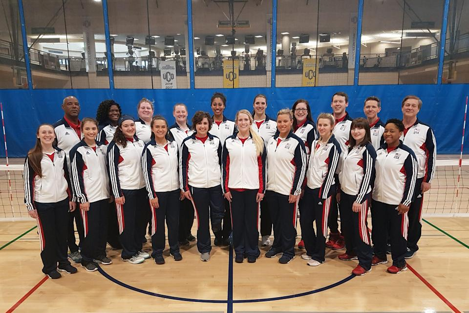 The USA Sitting Volleyball team posing for a team photo in their Team USA gear.