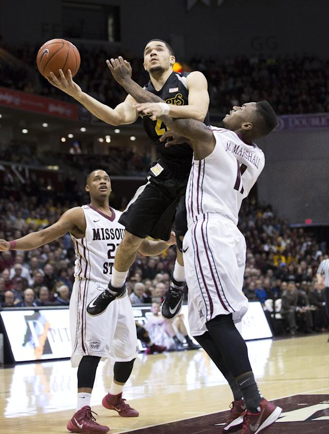 Wichita State guard Fred VanVleet (23) shoots the ball over Missouri State guard Marcus Marshall (11) during the first half of an NCAA college basketball game on Saturday, Jan. 11, 2014, in Springfield, Mo. (AP Photo/David Welker)