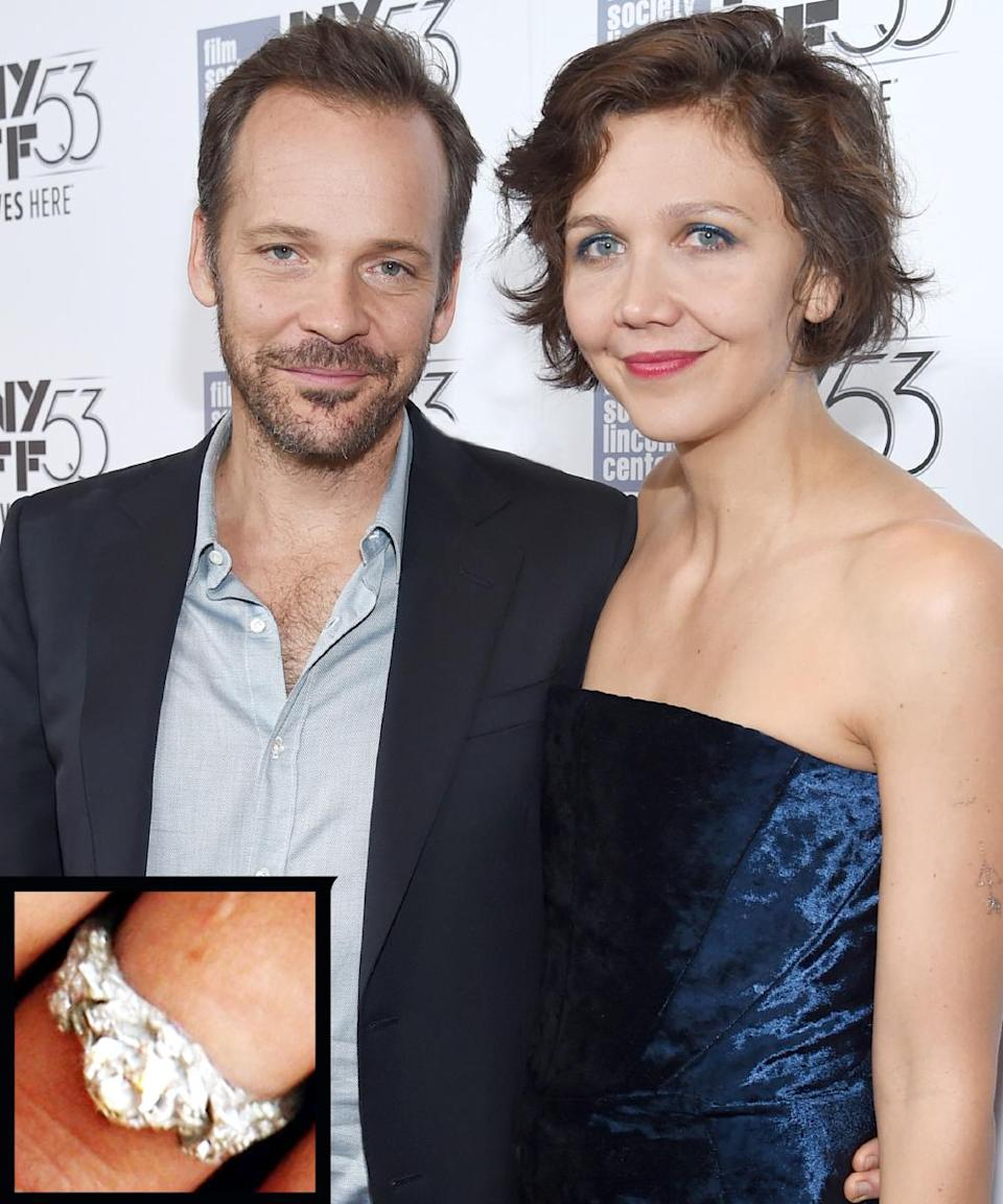 <p>Actor Peter Sarsgaard proposed to Maggie Gyllenhaal in 2006 with an antique diamond and platinum ring. The couple didn't get married until three years later, on May 2, 2009.</p>