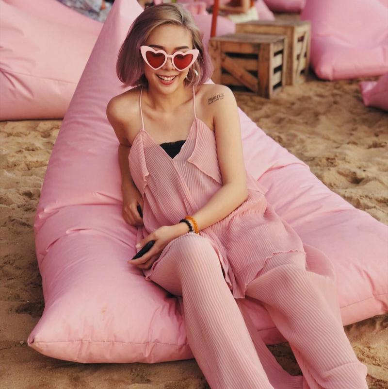Thai murder victim Sawaros Kimsee, 26, (pictured) wearing a pink jumpsuit and pink sunglasses.