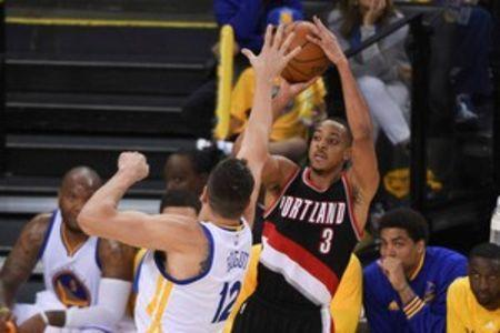May 1, 2016; Oakland, CA, USA; Portland Trail Blazers guard C.J. McCollum (3) shoots the basketball against Golden State Warriors center Andrew Bogut (12) during the fourth quarter in game one of the second round of the NBA Playoffs at Oracle Arena. Kyle Terada-USA TODAY Sports
