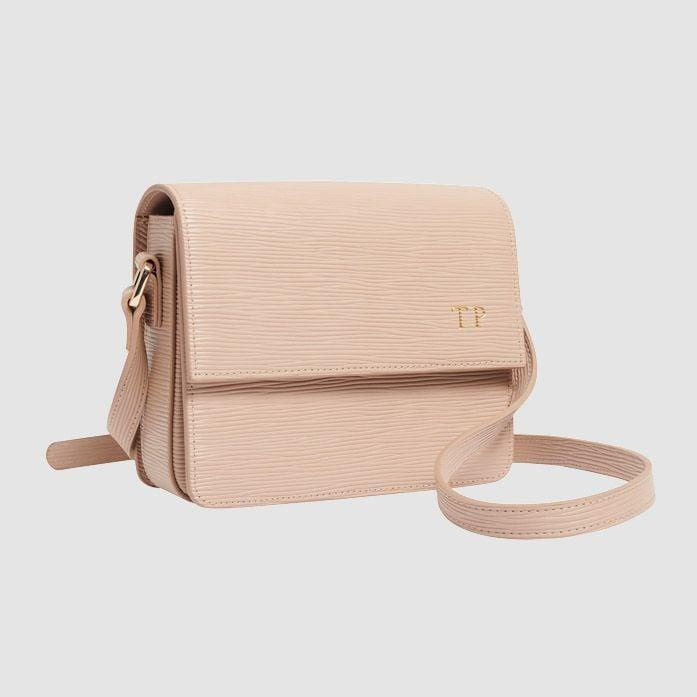 <p>You can get your initials embossed on this cute <span>The Daily Edited Taupe Textured Cross Body Bag</span> ($180).</p>