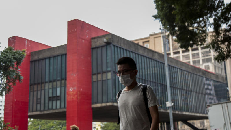 SAO PAULO, BRAZIL - MARCH 17: A man wearing a face mask walks in the front of Art Museum (MASP) on March 17, 2020 in Sao Paulo, Brazil. Earlier today, Brazil Health minister Luiz Henrique Mandetta confirmed a first decease related to COVID-19; there are 291positive cases in the country. (Photo by Miguel Schincariol/Getty Images)