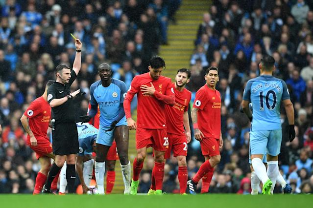 <p>Yaya Toure is booked by Michael Oliver, perhaps fortunate to avoid a red </p>