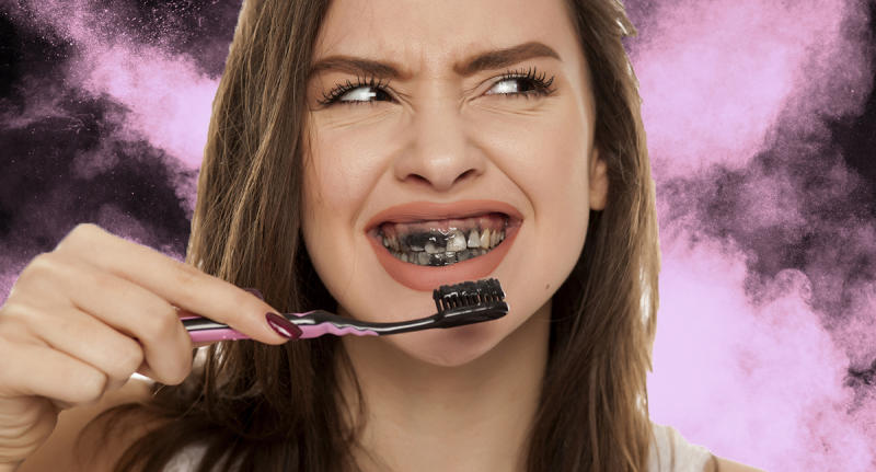 It looks gross, but this black powder will make your teeth sparkling white naturally. (Photo: Getty)