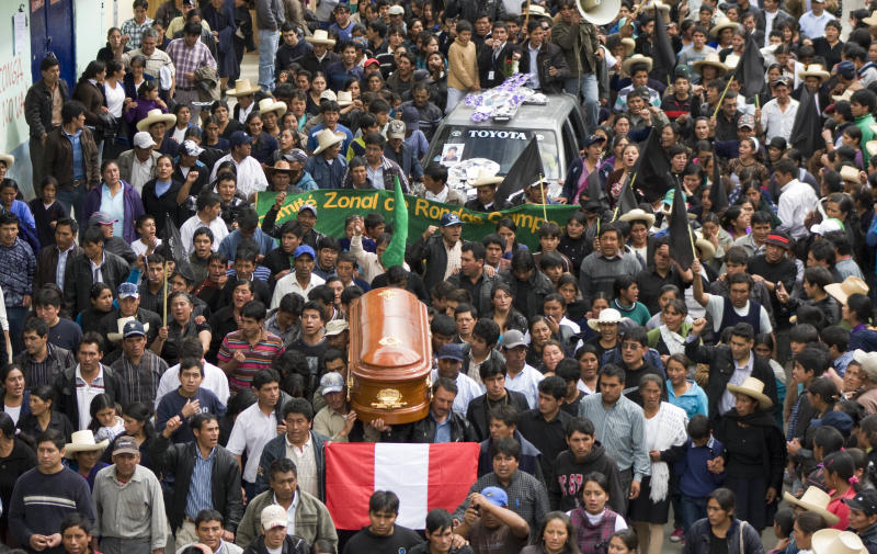FILE - In this July 7, 2012 file photo, hundreds join relatives and friends of Joselito Vasquez, killed in an anti-mine clash, in his funeral procession in Bambamarca, Peru. Protesters opposed to Peru's biggest mining project attacked a provincial town hall and battled police and soldiers on July 3, 2012, injuring at least 21 and claiming five lives including Vasquez. Civilian deaths are disturbingly frequent when protesters in provincial Peru confront police. Peru's crowd control tactics are unmatched in lethality according to the independent National Coordinator for Human Rights watchdog. (AP Photo/Francisco Vigo, File)