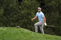 Jon Rahm walks to the 18th green after hitting from the bunker during the third round of the Zozo Championship golf tournament Saturday, Oct. 24, 2020, in Thousand Oaks, Calif. (AP Photo/Marcio Jose Sanchez)